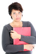 Exasperated, overworked woman clutching paperwork