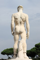 Virile statue in the Marbles Stadium of Rome, Italy