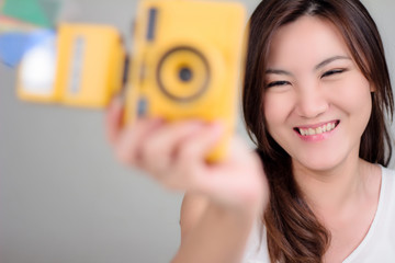 ASIAN GIRL WITH CAMERA