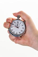 Hand mit Stoppuhr zur Zeitmessung