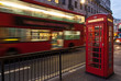 Double decker bus and red telephone box in London at night