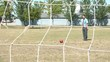 Businessman Kicks Soccer Goal