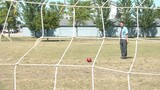 Businessman Kicks Soccer Goal