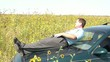Businessman Relaxing in Sunflower Field on Tablet