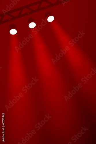 Three spotlights on a rich red smoky background