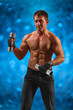 a muscular male with dumbbells