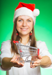 Cheerful girl in a Christmas hat