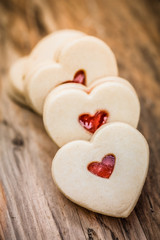 Heart-shaped cookies on wooden table
