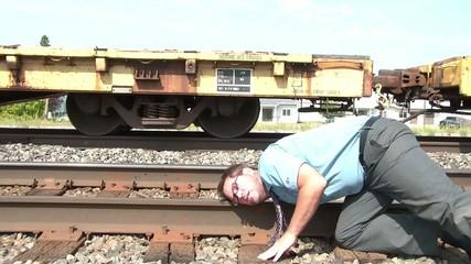 Businessman Puts Ear to Railroad Track Metaphor