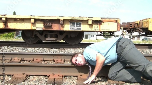 Businessman Puts Ear to Railroad Track Metaphor