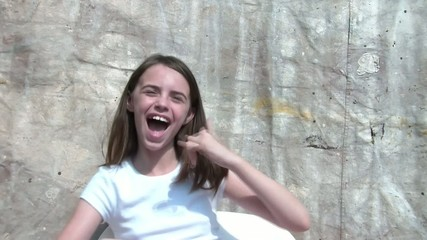 Girl Doing Call Me Gesture, Smiling, & Laughing