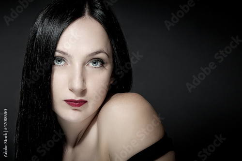 Portrait of beautiful girl with black hairs