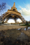 Dramatic view of Eiffel Tower with Sky on Background