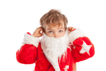 Small boy dressed as Santa Claus, isolation