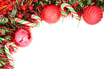 Christmas border of baubles, garland and candy canes