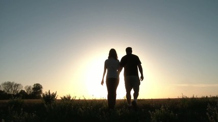 Romantic Couple Walks Into Sunset