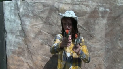 Cowgirl Shooting Guns with Fake Teeth