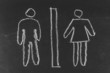 Men and women symbols drawn on blackboard background