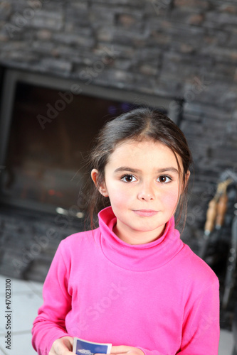 Little girl playing card game alone