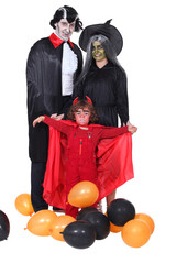 parents and child celebrating Halloween