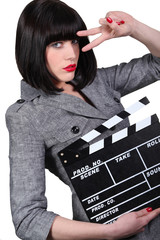 Take two: Girl with a film clapperboard
