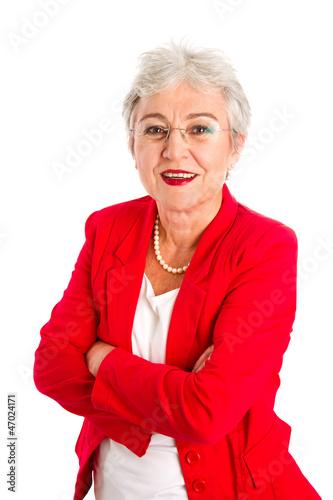 Leinwanddruck Bild Ältere Dame mit Brille in Rot