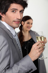 Elegant man drinking champagne