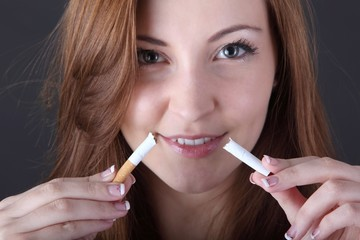 woman and stop smoking cigarette (focus on cigarette)