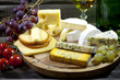 Cheese and wine various assortment vintage still life in night