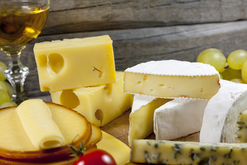 Cheese and wine various assortment on wooden boards