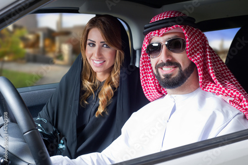 arabian couple in a newely purchased car enjoying life