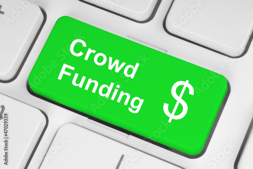 Green crowd funding button on keyboard