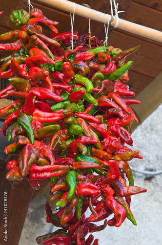 Red hot peppers hanging on the wall.