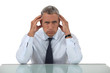Senior businessman with headache
