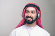 Arabian middle eastern guy with headphones enjoying music