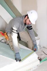 Man installing wall panels