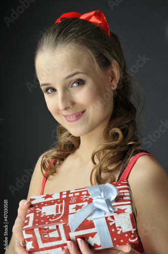 Christmas  girl  holds  gift boxes and ice cream