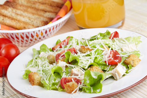 The Caesar salad with chicken and tomatoes