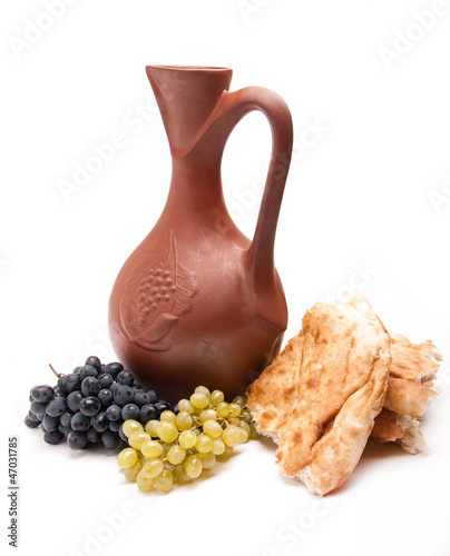 traditional clay jug wine with grapes and lavash