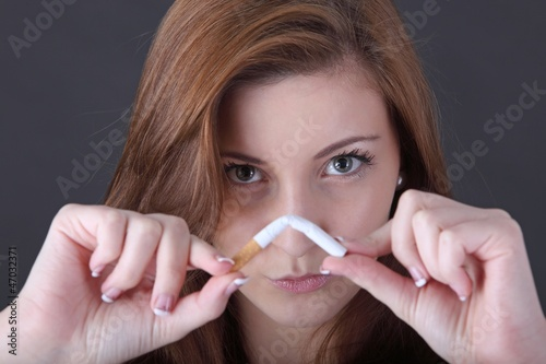 woman and stop smoking cigarette (focus on face)