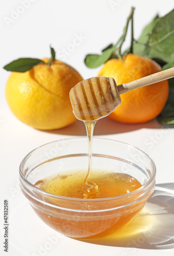 Honey and Mandarins isolated on white