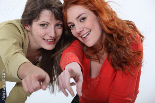 Two women pointing