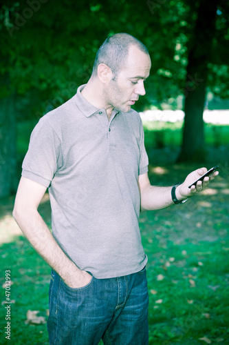 Man with Mobile Phone at Park