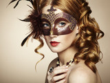 Fototapety Beautiful young woman in brown mysterious venetian mask