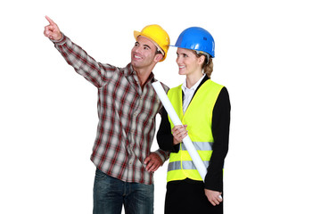 Architect and builder pointing into blank copyspace