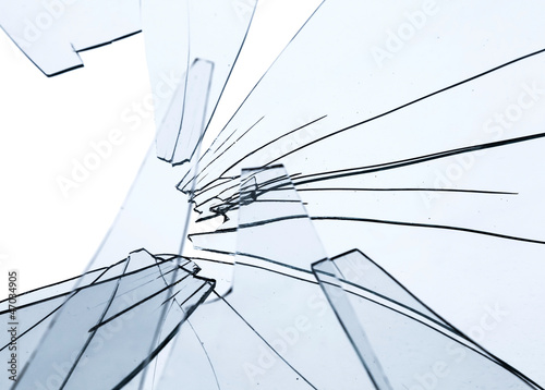 Broken glass fragments above white