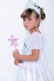 Little girl dressed as princess holding wand