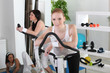 Three women working out in a gym
