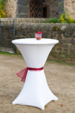 Bar table decorated for outdoor wedding poster