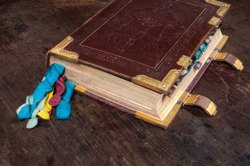 Medieval book with colorful ribbons